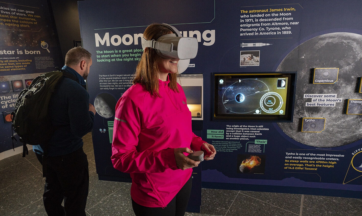 Woman with virtual reality headset at OM