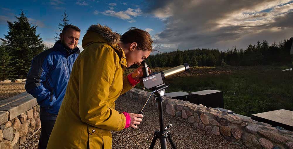 Woman using a solar telescope