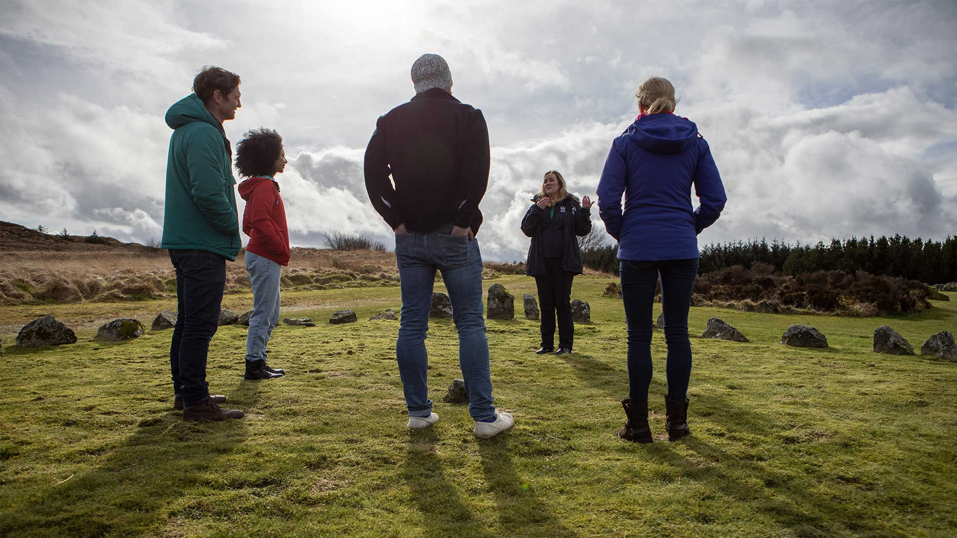 Group of people with a tour guide at Beaghmore Stone Circles